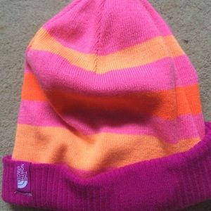 The North Face bright pink striped beanie hat